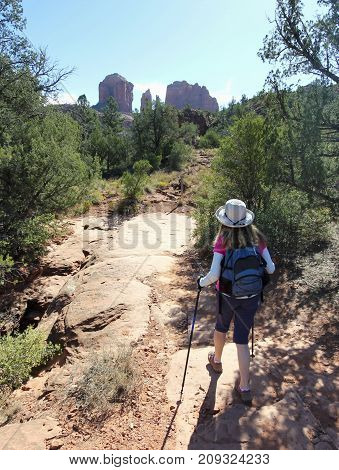 SEDONA, ARIZONA, OCTOBER 11. The Baldwin Trail on October 11, 2017, near Sedona, Arizona. A Woman Hikes the Baldwin Trail Toward Famous Cathedral Rock Near Sedona in Arizona.