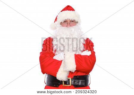 Kind Santa Claus standing with crossed arms, isolated on white background.