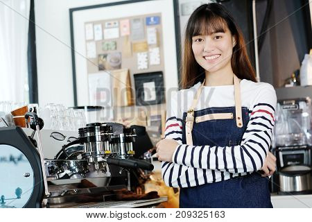 Young asian women Barista standing with smiling face in font of cafe counter background small business owner food and drink industry concept