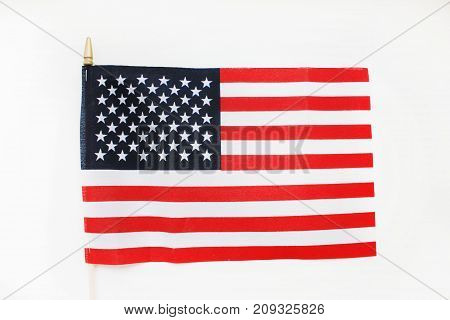 Flag of United States of America Isolated on White. National country symbol, also known as Stars and Stripes. Red, white and blue color, detailed wallpaper of American flag with 13 stripes and 50 stars
