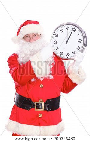 Kind Santa Claus pointing to clock, isolated on white background.