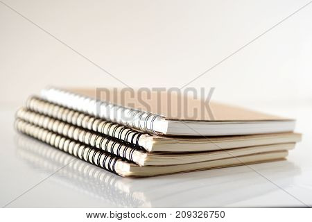 Stack of notebooks on white background, Education conceptual