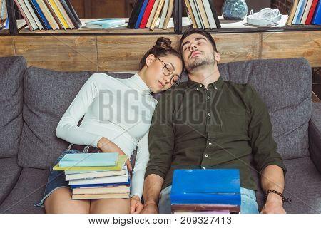 Sleeping Couple With Books