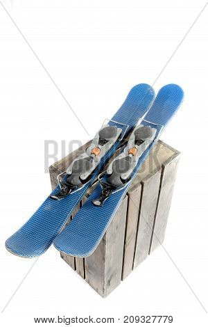 Ski blades isolated and a wooden crate on a white background