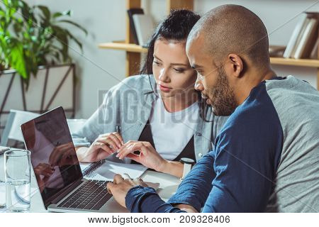 Multiethnic Couple Using Laptop