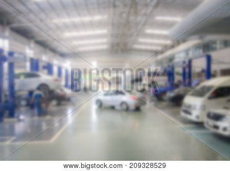 Blurred image of automotive service repair center.