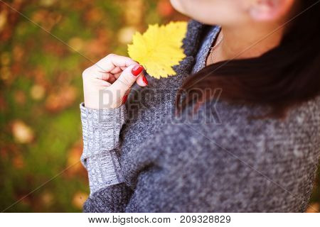 Portrait Of A Girl With An Autumn Leaf In Her Hand