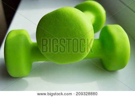 The Concept Of Fitness, A Healthy Lifestyle - Two Green Dumbbells For Sports