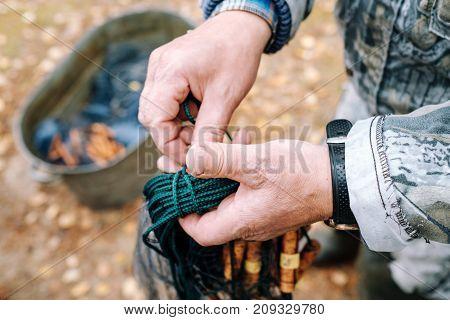 Fisherman holding fishing net in her hands