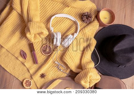 Autumn. Cozy. Knitted Warm Clothes. Home Comfort. Warm Autumn. Sweaters And Hat On A Wooden Backgrou