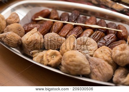 dried figs and dates on a tray