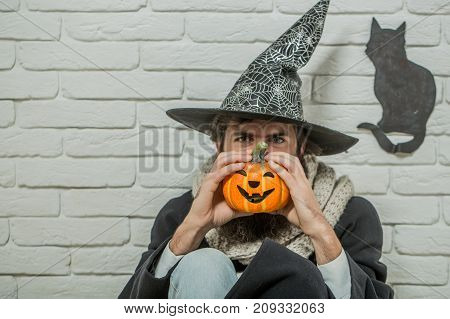 Halloween Man In Witch Hat Sitting On Floor