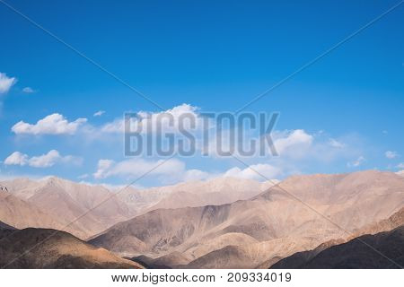 Closeup image of mountains and blue sky with clouds background in Ladakh India