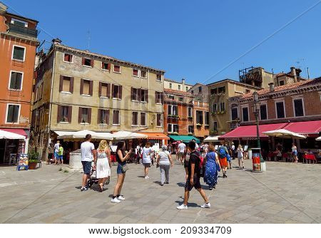 Venice Italy - June 20 2017: View to architecture old city in Venice Italy. Unrecognizable people are walking down the street in the old center.