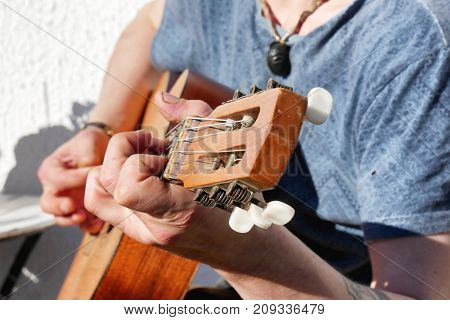 a close up of the guitarist's hands