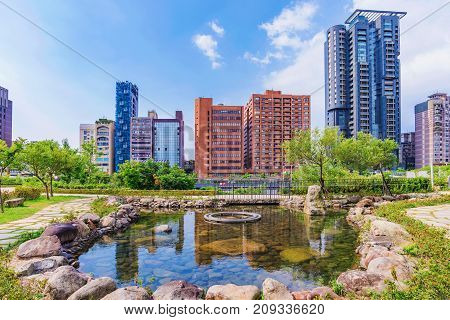 TAIPEI TAIWAN - JULY 23: This is the nature of Daan forest park with a view of modern skyscrapers in the downtown area on July 23 2017 in Taipei