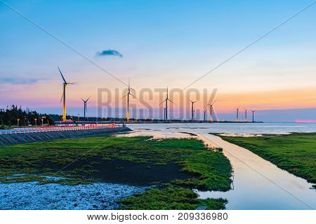 Scenic evening view of wind farm in Gaomei wetlands