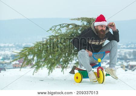 Man Riding Tricycle On Snowy Landscape