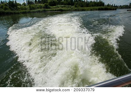 waves on the water from the motor of the ship