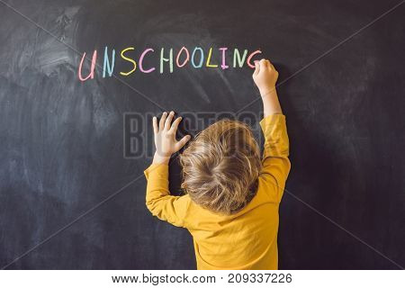 Concept Unschooling Home Learning Back To School Color Chalk On Black Blackboard Background In Row T