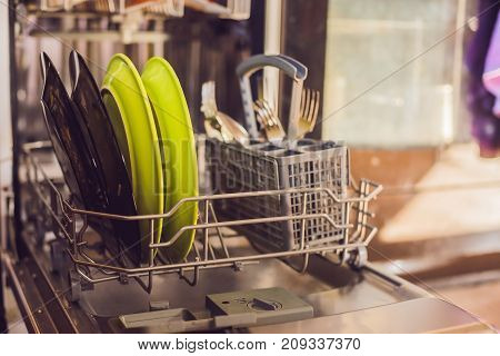 Dishwasher With Dirty Dishes. Powder, Dishwashing Tablet And Rinse Aid. Washing Dishes In The Kitche