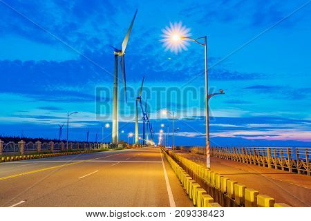 Wind turbines at night in Gaomei Wetlands
