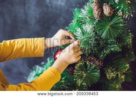 The Boy Wrote An Inscription Merry Cristmas. Christmas Tree. Xmas Child And New Year Holiday