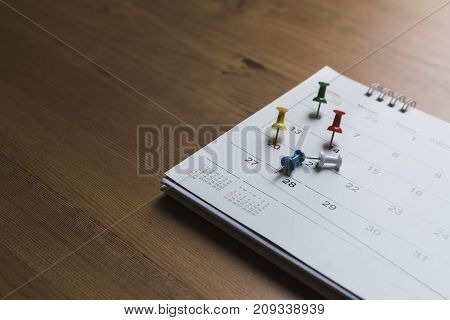 close up of calendar on the table planning for business meeting or travel planning concept