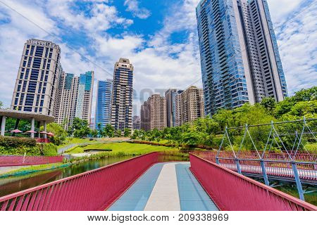 TAICHUNG TAIWAN - JULY 18: This is a view of skyscrapers and modern architecture in Maple Garden a popular park in the downtown financial district area on July 18 2017 in Taichung