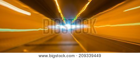 Light at end of tunnel abstract lines of yellow light lead to bright spot at end of tunnel
