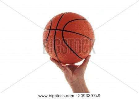 Male hand with basketball isolated on white background. Man holding ball sport equipment and recreation concept.