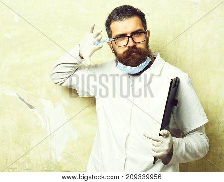 Bearded Brutal Caucasian Doctor Or Postgraduate Student Holding Clipboard