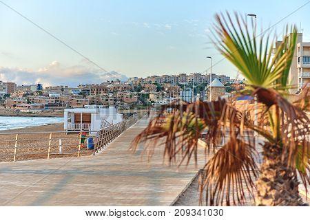 Wooden boardwalk along the beach of La Mata. Costa Blanca Province of Alicante. Spain