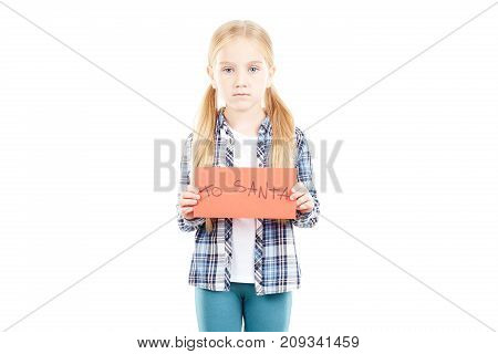 Portrait of little girl holding envelope with letter to Santa