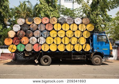 Truck Loaded With Empty Yellow And Colorful Oil Barrels In Kochi, South India.