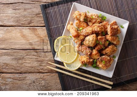 Spicy Chicken Karaage With Lemon And Green Onion Close-up. Horizontal Top View