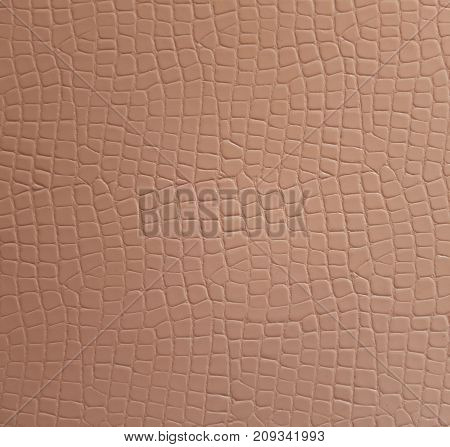 Texture of a beige leatherette close up
