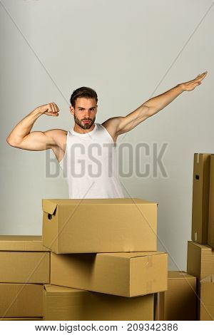 Man Standing Among Boxes And Pretending To Fly Like Superhero