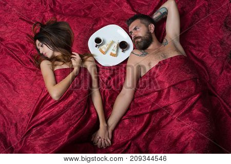 Man With Beard Lying With Pretty Lady In Bed