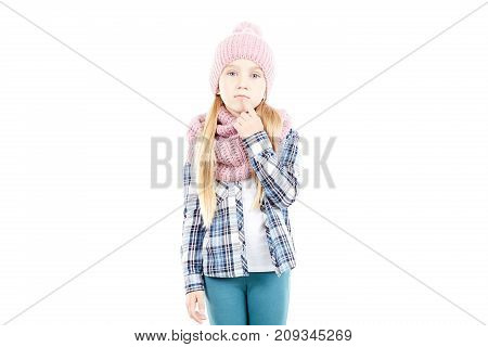 Studio portrait of little girl wearing knit hat and snood scarf