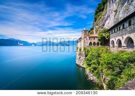 Hermitage or Eremo of Santa Caterina del Sasso medieval roman catholic monastery. Leggiuno Maggiore lake Lombardy Italy Europe. Long Exposure.