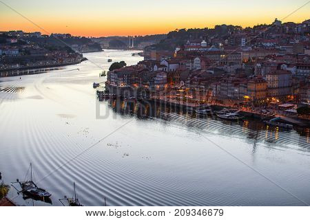 Douro river and Ribeira from Dom Luis I bridge at night, Porto, Portugal.