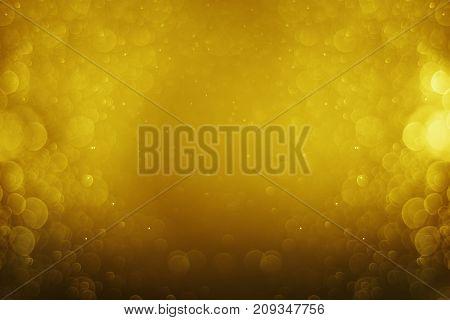 Glitter light gold bokeh christmas night blurred black background