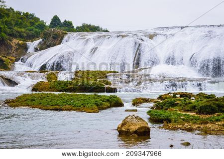 China Guizhou Tupotang waterfall located in Huangguoshu scenery park. The park is a popular tourism attraction in Guizhou Province China.