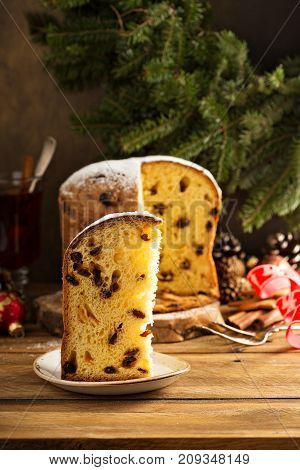 Traditional Christmas panettone with raisins and dried fruits