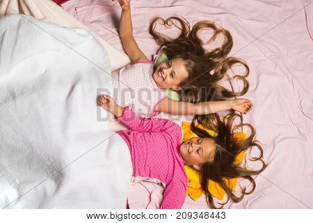 Children With Happy Faces And Hearts In Loose Hair
