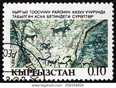 KYRGYZSTAN - CIRCA 1993: a stamp printed in the Kyrgyzstan shows Cave Paintings Petroglyphs Heritage circa 1993