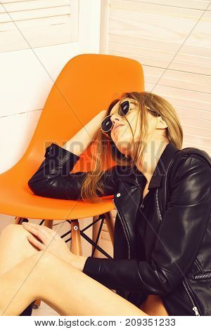 Pretty Sexy Woman In Sunglasses, Leather Jacket At Orange Chair
