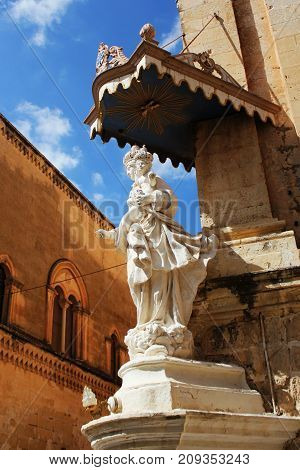 Statue of Virgin Mary with Jesus child on the corner of Carmelite Priory in Mdina. Malta .