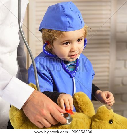 Father And Kid With Curious And Happy Face Playing Doctor.